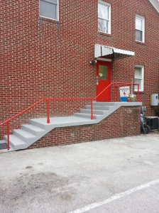 Doesn't our back porch look fabulous!  Donnie and Reynold were at it again, painting the door and railing Episcopal red.