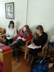 From L to R:  Lindsey, Kayla, and Caitlyn complete Volunteer Applications.