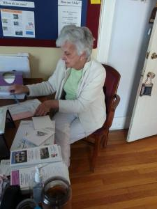 Volunteer Shirley Childs writes thank you notes for recent donations
