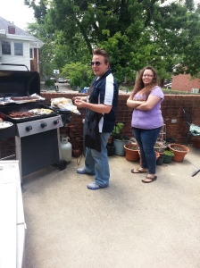 Justin Cline and Mary Alcius cooking lunch on the grill