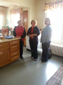 Flo Mayer, The Rev. Anisa Cottrell Willis, and Sharon Holbrook getting ready for lunch