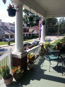 Our porch is decorated in red, white and blue for July 4th.