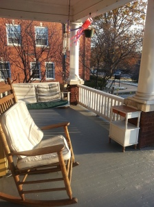 The wind was making the rocking chairs rock and the swings swing.