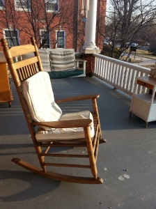 Light on the empty rocking chair, waiting for warmer weather.